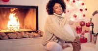 Beautiful black woman seated beside white tree