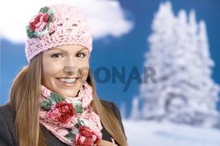 Pretty girl dressed up warm enjoying wintertime
