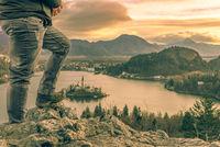 Man climbed on rocks at sunrise