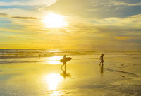 Surfer with surfboard, tropical beach
