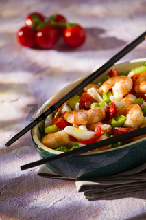 Salad of shrimps and chopsticks