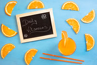Juice and orange slices as daily vitamins