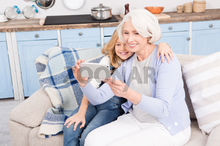 Grandmother and granddaughter making selfie photos