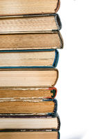 Stack of old books on the side on white isolated background. Love read concept. Knowledge symbol. Books day