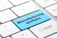 Manufacuring concept: Manufacturing Workers on computer keyboard background