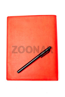 Red copybook and pen