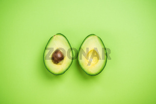 Avocados halves creative food concept