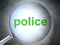 Law concept: Police with optical glass