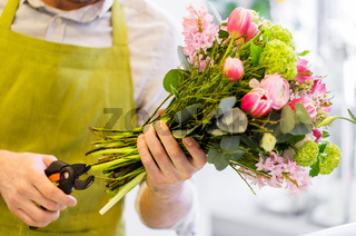 close up of florist man with flowers and pruner