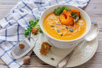 Spicy pumpkin soup with greens.