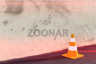 a traffic cone on a wall