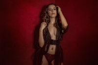 brunette girl in lingerie on red textured background, sensual scene