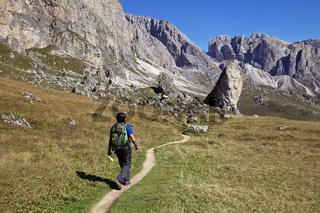 A tourist hiking in Val di Gardena in the Dolomites