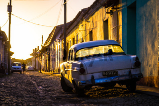 Trinidad, Cuba: Street with oldtimer at sunset