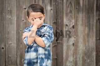 Frustrated Mixed Race Boy With Hand on Face