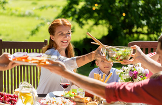 happy family having dinner or summer garden party