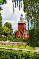 Cemetery with a red Wooden Church
