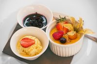 Creme brulee dessert with fruits vith ice cream