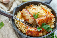 Steamed sauerkraut with grilled sausages.