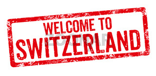 Red stamp on a white background - Welcome to Switzerland