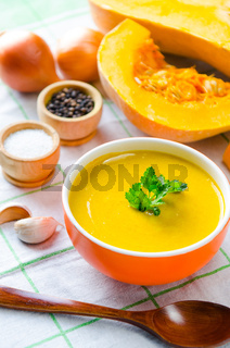 Pumpkin soup served on the table in bowl