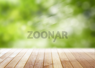 Empty wooden table with blurred defocused tree in park outdoors background