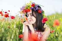 Portrait of young pretty girl with flower wreath