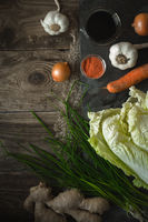 Chinese cabbage, vegetables and soy sauce kimchi on old boards