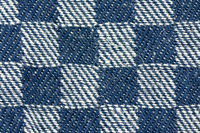 close-up of a blue white square detailed structured fabric patte