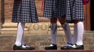 Catholic School Girls With Skirts And White Socks