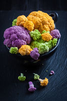 Assortment of organic cauliflower from local market on wooden background