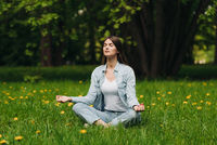 Young girl meditating in park
