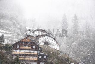 Dense snowfall over mountain village