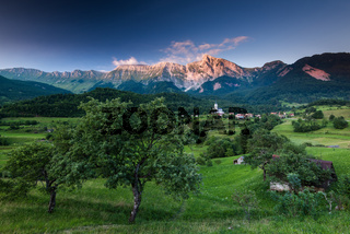 Stunning sunset light on Alps in Slovenia village Dreznica