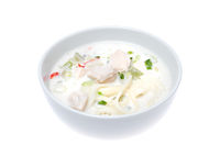 Bowl of thick chicken soup over white background