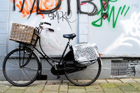 Black bicycle for woman with load basket