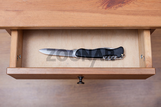 foldable knife in open drawer