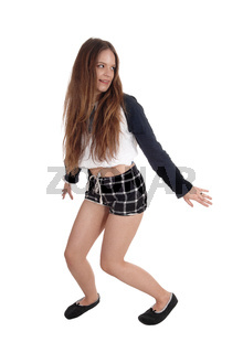 Woman dancing in checkered shorts