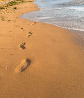 Footprints in the sand beach, Landscapes Extreme tourism and traveling, wave and footsteps