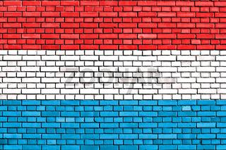 flag of Luxemburg painted on brick wall