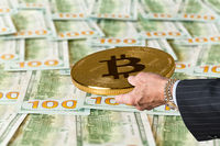 Bitcoin held over 100 dollar US bills or notes