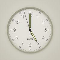 a clock shows 5 o'clock