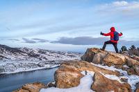 hiking at dawn over frozen mountain lake