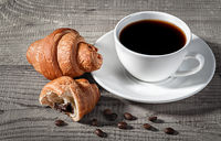Coffee and croissants on a wooden table