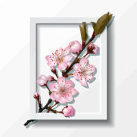 Branch of pink sakura cherry flowers in frame