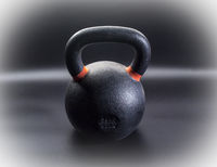 heavy iron kettlebell - fitness concept
