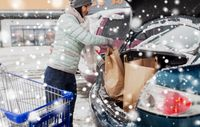 customer loading food from shopping cart to car