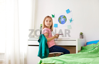 little girl doing homework or drawing at home