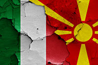 flags of Italy and Macedonia painted on cracked wall