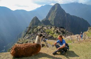 Tourist and llama in Machu Picchu